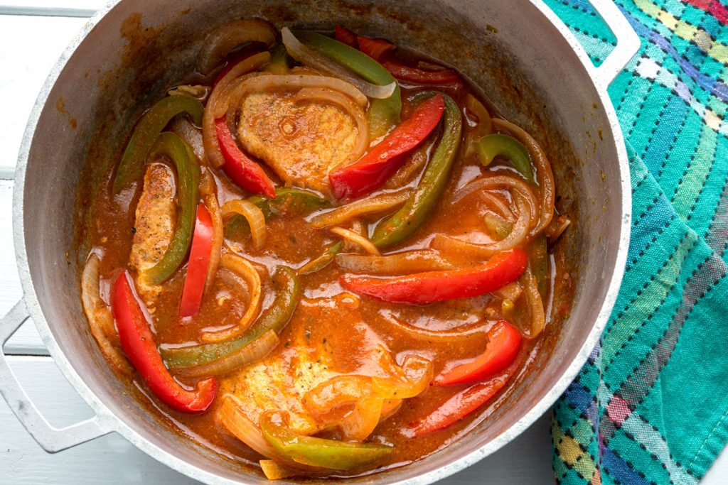Stewed pork chops with peppers and onions
