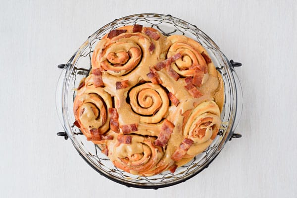 Maple bacon cinnamon rolls take the sweet and salty combo to new heights! Classic cinnamon rolls are stuffed with bacon and topped with a maple icing...plus more bacon!