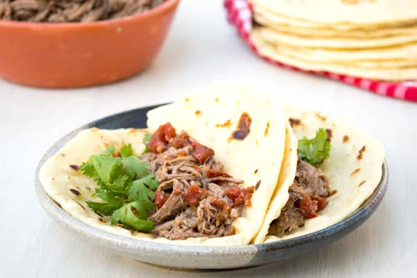 Authentic Mexican shredded machaca beef recipe in the crockpot. Delicious in tacos or with eggs!