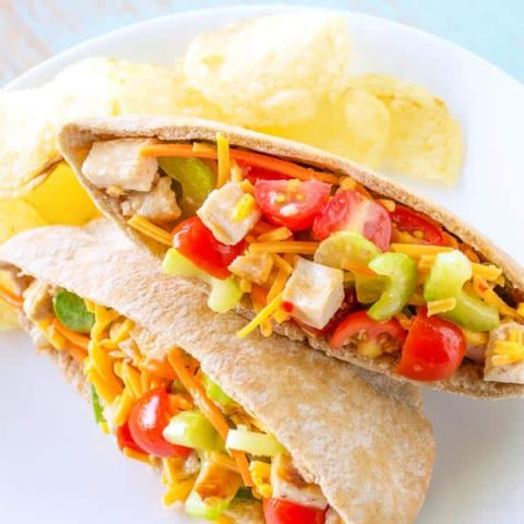 Chicken Veggie Pitas chock full of cheese, celery, carrots and tomatoes!