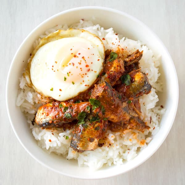 Healthy sardine rice bowl with canned sardines in tomato sauce. Skip the crackers and top with egg for an easy dinner!