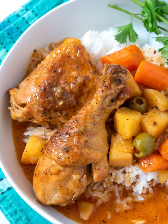 Plate of stewed chicken over rice
