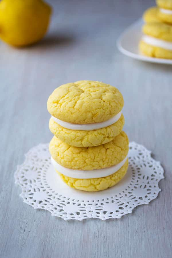 Velvety soft and chewy lemon sandwich cookies with tangy cream cheese frosting! They start with a cake mix and can be ready in 30 minutes!
