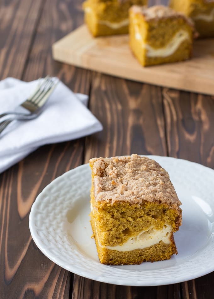 Pumpkin Coffee Cake layered with cream cheese and a streusel topping! | Kitchen Gidget