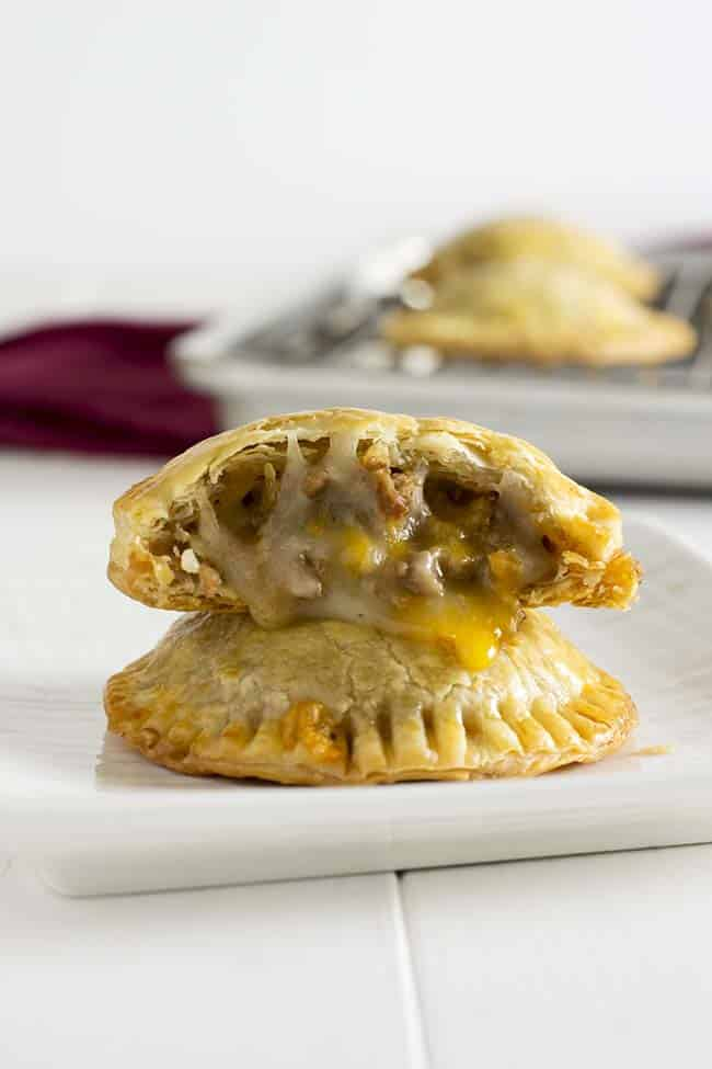 Cheesy beef and bean taco hand pies. Great party appetizer or alternative to Taco Tuesday! | Kitchen Gidget