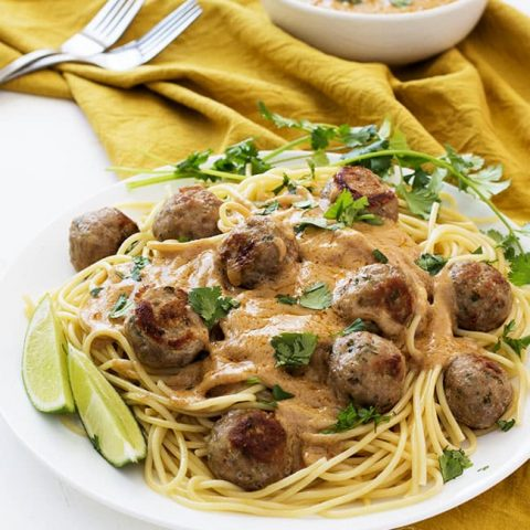 Thai meatballs served with red curry peanut sauce over noodles and you get Thai Spaghetti & Meatballs! Healthy, clean eating! | Kitchen Gidget