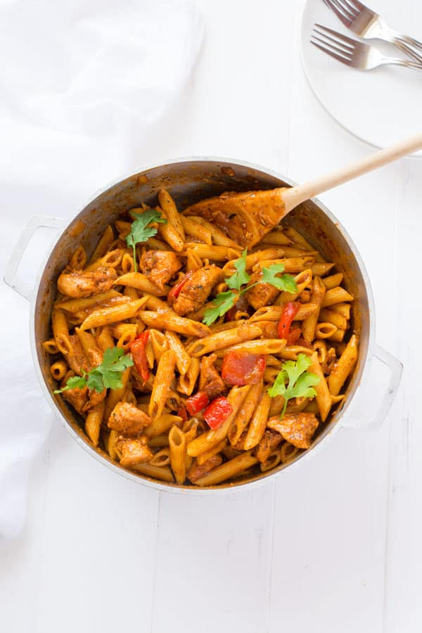 Puerto Rican Chicken Pasta: juicy bites of chicken, sautéed peppers and onions, and penne pasta to soak up a delicious sofrito-based broth! | Kitchen Gidget