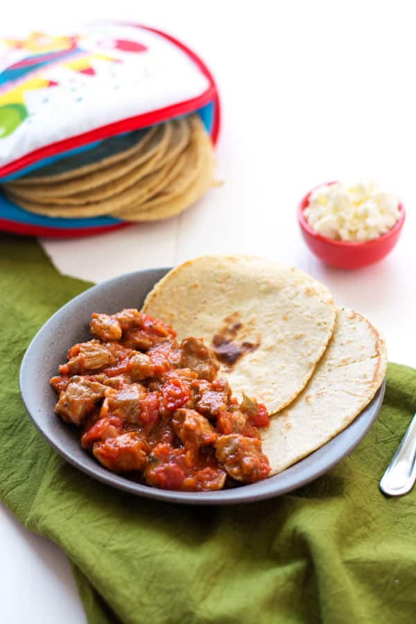 Mexican Pork Stew (Puerco en Salsa Roja) is an easy dinner with only 2 ingredients! Serve with homemade corn tortillas.   Kitchen Gidget