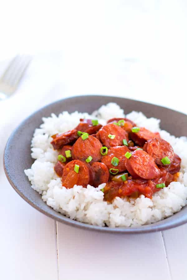 Smoked sausage creole is a riff on classic shrimp creole simmered in a simple sauce of tomatoes, peppers and onion. Serve with rice for an easy dinner! | Kitchen Gidget