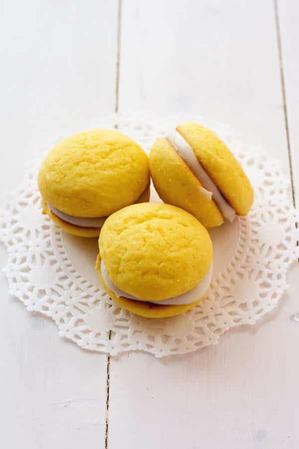 Lemon Ricotta Sandwich Cookies. They start with a cake mix and are super spongy with a sweet ricotta filling!