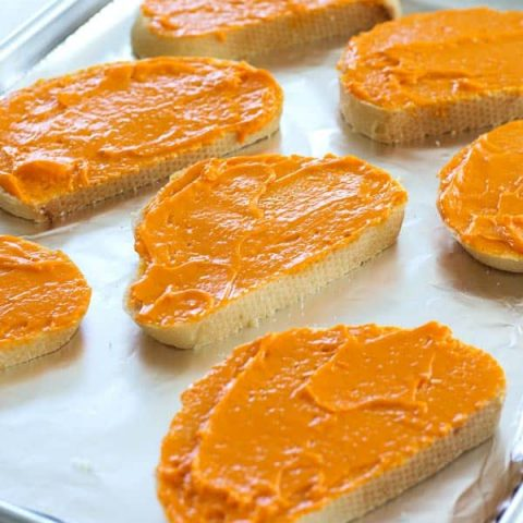 Cheddar cheese spread recipe for the best cheesy bread you've ever had! Spread on sourdough and broil until bubbly!