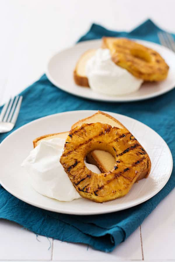 Juicy grilled pineapple with mascarpone whipped cream. A heavenly match for those long summer days!