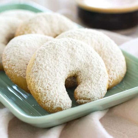 Almond Crescents made with ground almonds, flavored with vanilla and dusted with powdered sugar. These buttery crescents are crisp on the outside and tender on the inside. They're perfect snowy cookies for the holidays!