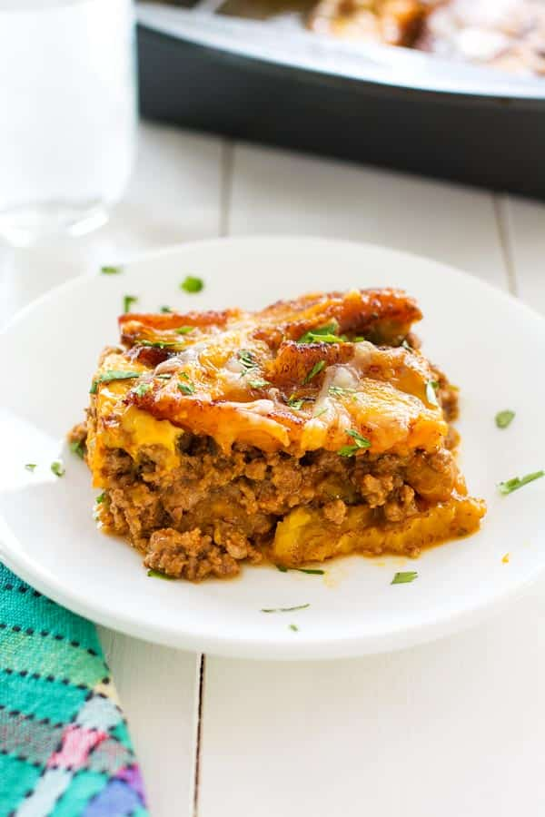 Puerto Rican Lasagna (Pastelón) with sweet slices of plantains instead of noodles, saucy beef picadillo and plenty of cheese.