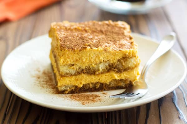 Pumpkin Tiramisu turns your favorite latte into the perfect Fall dessert! Espresso, ladyfingers and pumpkin spice custard magic!