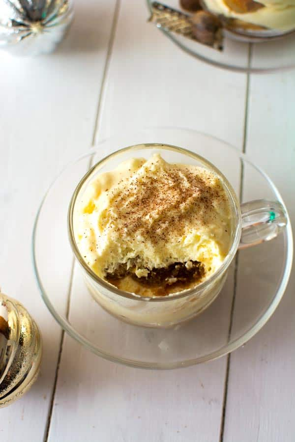Try this Eggnog Tiramisu for the holidays! Authentic Italian tiramisu with the flavor of creamy holiday eggnog, nutmeg and espresso dipped ladyfinger cookies!