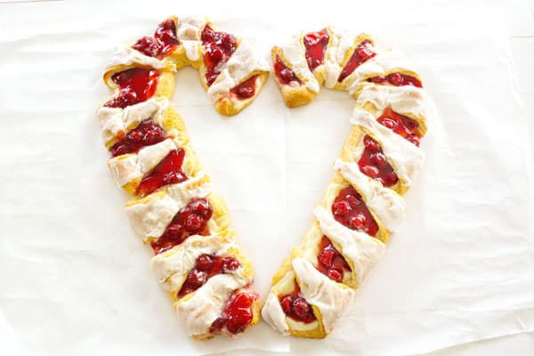 Christmas Breakfast Danish: cherry cheese pastry in candy cane shape! Easy to make with crescent rolls, cherry pie filling and cream cheese.