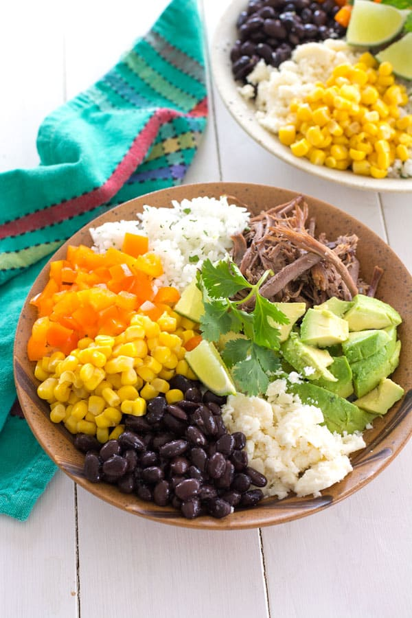 Make a healthy chicken burrito bowl with this homemade burrito bowl recipe!