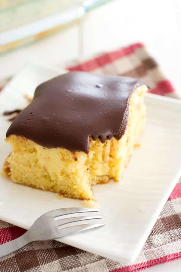 Easy Boston Cream Poke Cake recipe with delish chocolate ganache! Popular at potlucks!
