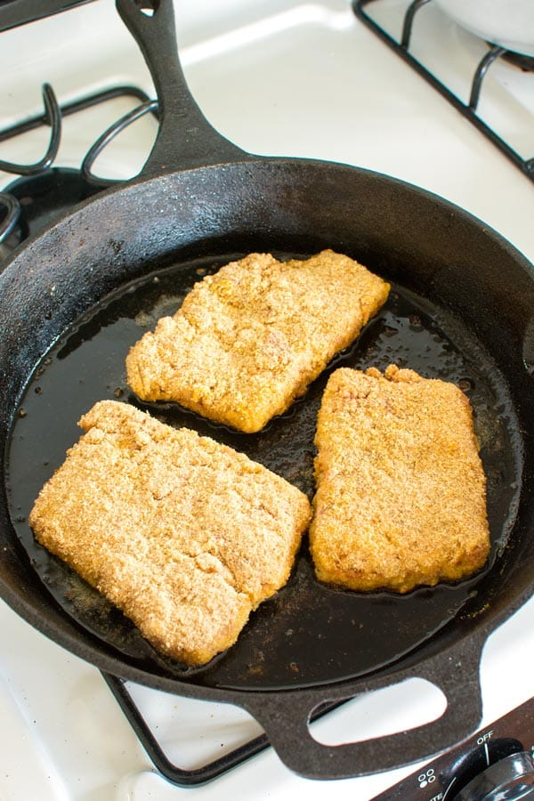 Breaded cube steaks (bistec empanizado) frying in pan for easy dinner!