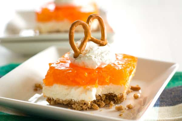 Tropical Orange Pretzel Salad - jello pretzel salad recipe with a pineapple orange twist!