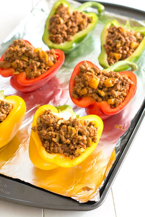 Ground beef picadillo stuffed peppers - a quick and delicious dinner recipe with a Puerto Rican twist!