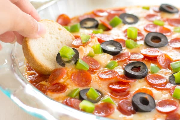 Easy pizza dip recipe with cream cheese and pepperoni. A Super Bowl appetizer favorite!