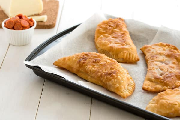 Easy Puerto Rican Pizza Empanadas (empanadillas de pizza) with pepperoni and cheese!