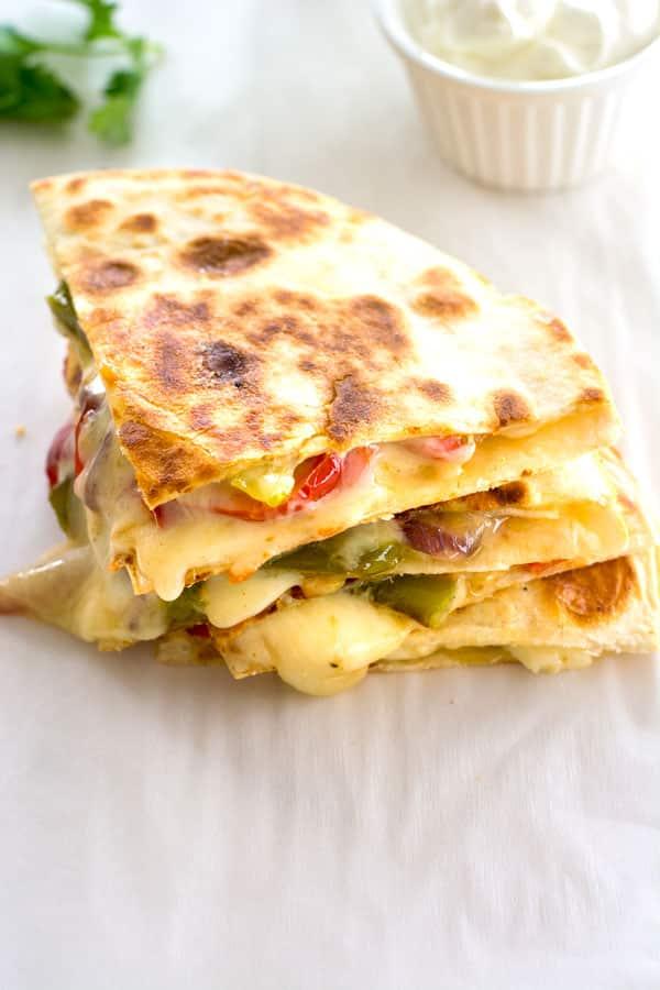 Mexican fajita vegetables are the star of this fajita veggie quesadilla. An easy vegetarian quesadilla everyone will love!