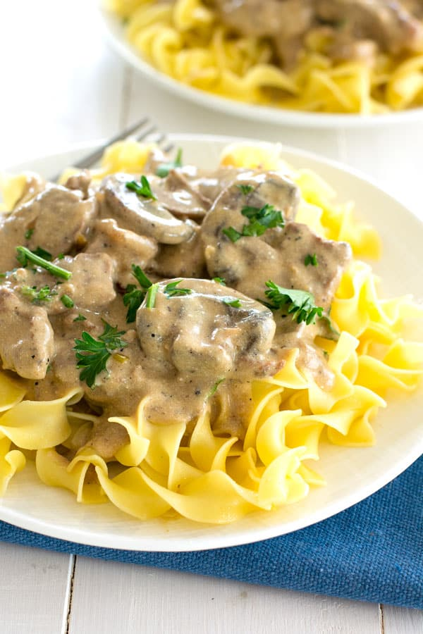 Easy homemade beef stroganoff recipe from scratch with steak and the most delicious sour cream sauce!