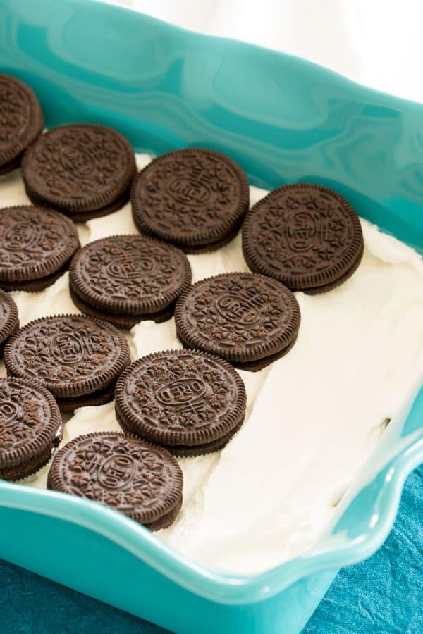 No bake Oreo dessert with layers of Oreo cookies and homemade whipped cream