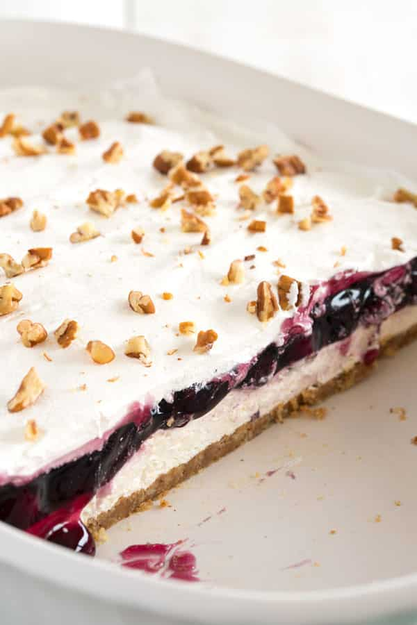 Blueberry Delight with graham cracker crust - cheesecake meets blueberry fluff in this no bake dessert!