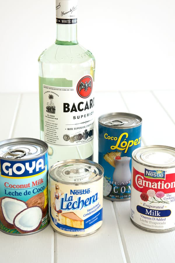 Coquito recipe ingredients for Puerto Rican coquito: rum, evaporated milk, coconut milk, cream of coconut, sweetened condensed milk