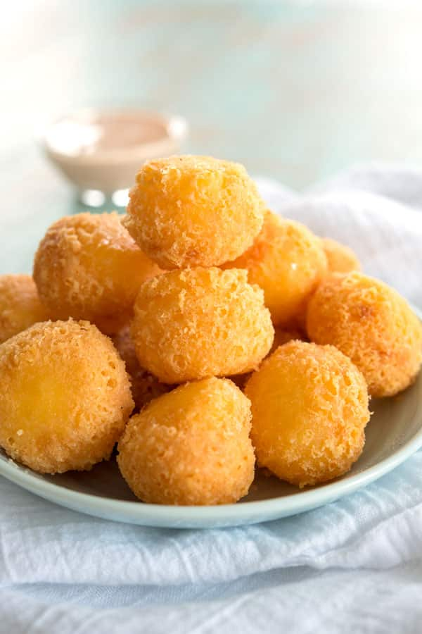 Plate of bolitas de queso (fried cheese balls) - an easy 3 ingredient appetizer!