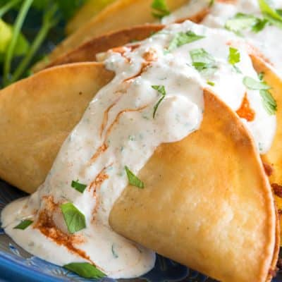 Tacos dorados de papa (crispy fried potato tacos) with a tasty queso fresco sauce!