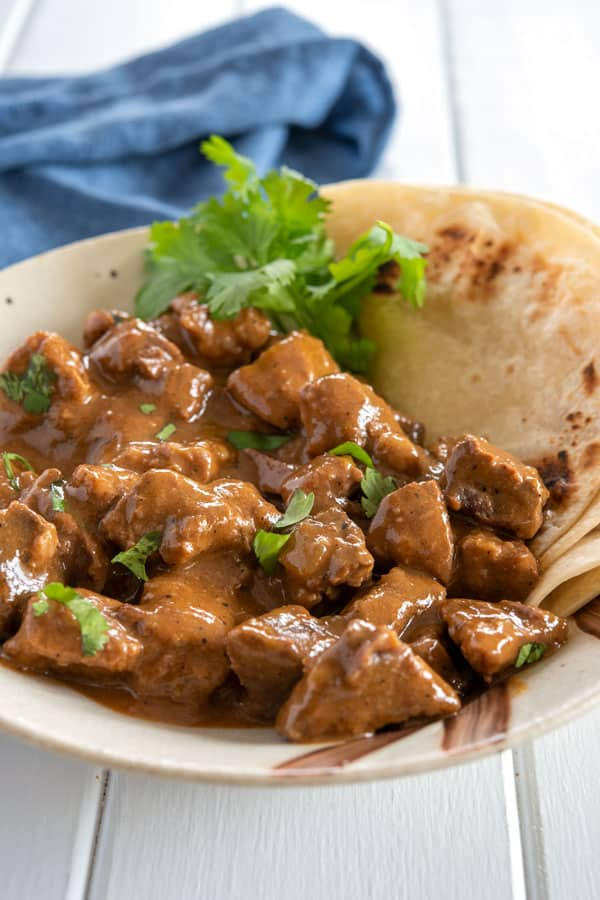 Easy carne guisada recipe - tender chunks of beef in Mexican gravy! Authentic recipe from Texas data-pin-description=