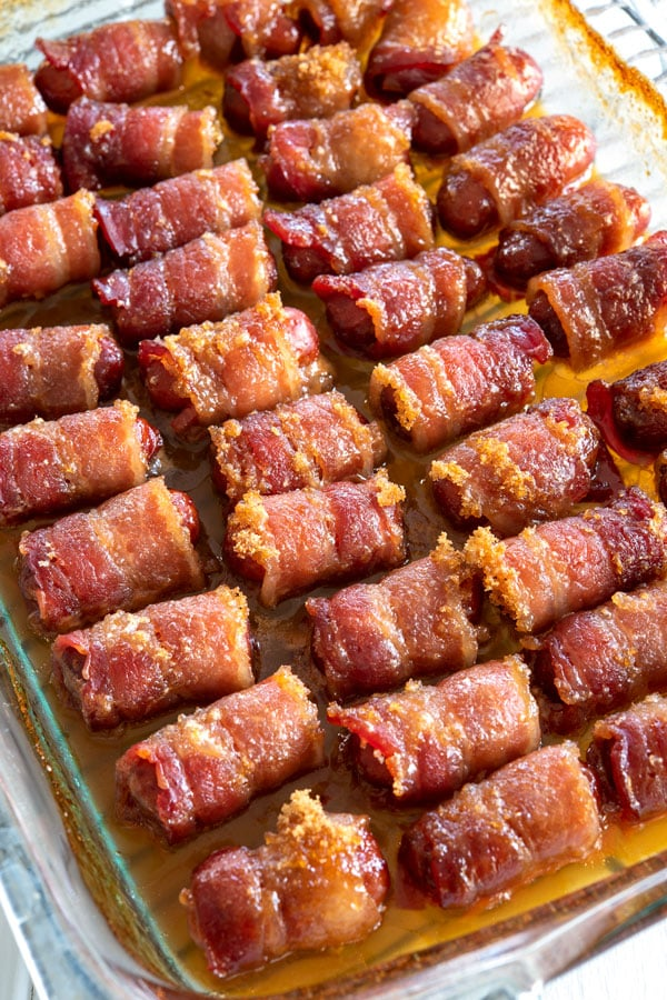 Little Smokies Wrapped in Bacon with brown sugar after baking #appetizers #appetizerseasy #easyappetizerideas #superbowlparty