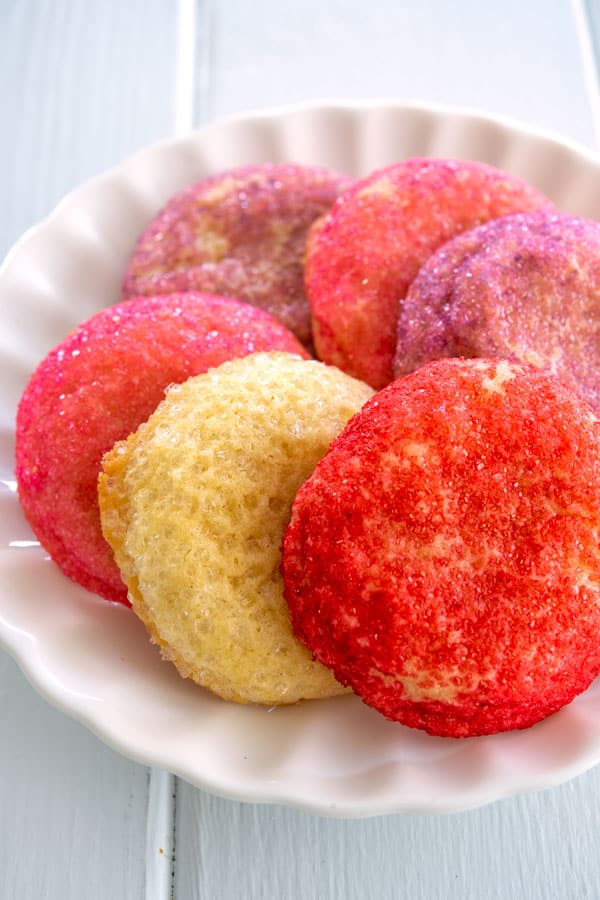 Small plate of French butter cookies rolled in red, pink, purple sugar