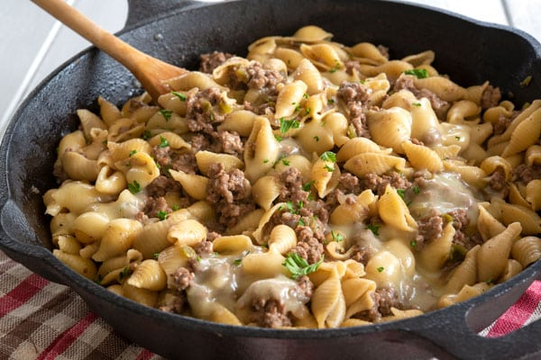 Philly Cheesesteak Pasta in the skillet with melted cheese on top