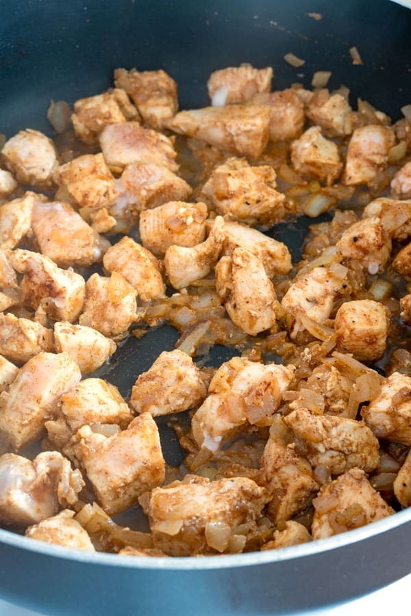 Sauteed cubes of chicken for enchilada pasta