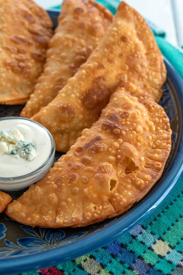 Plate of buffalo chicken empanadas