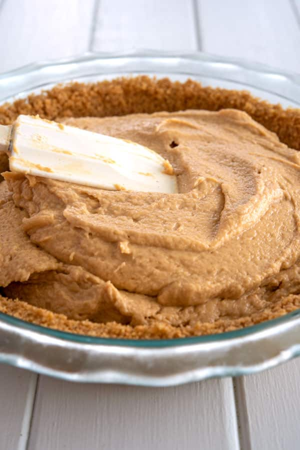 Spreading the filling in pie crust for no bake peanut butter pie