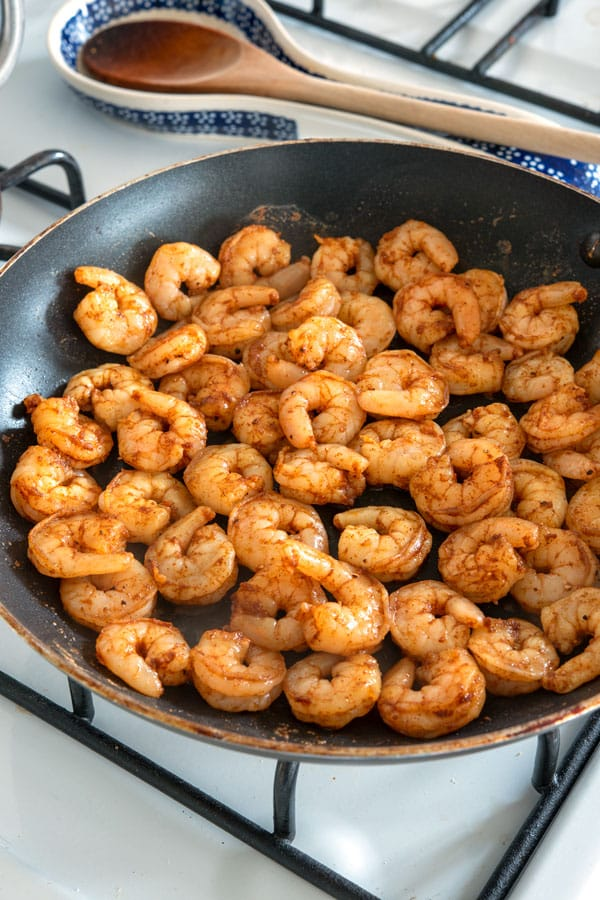 Cooking shrimp in a pan for shrimp tacos