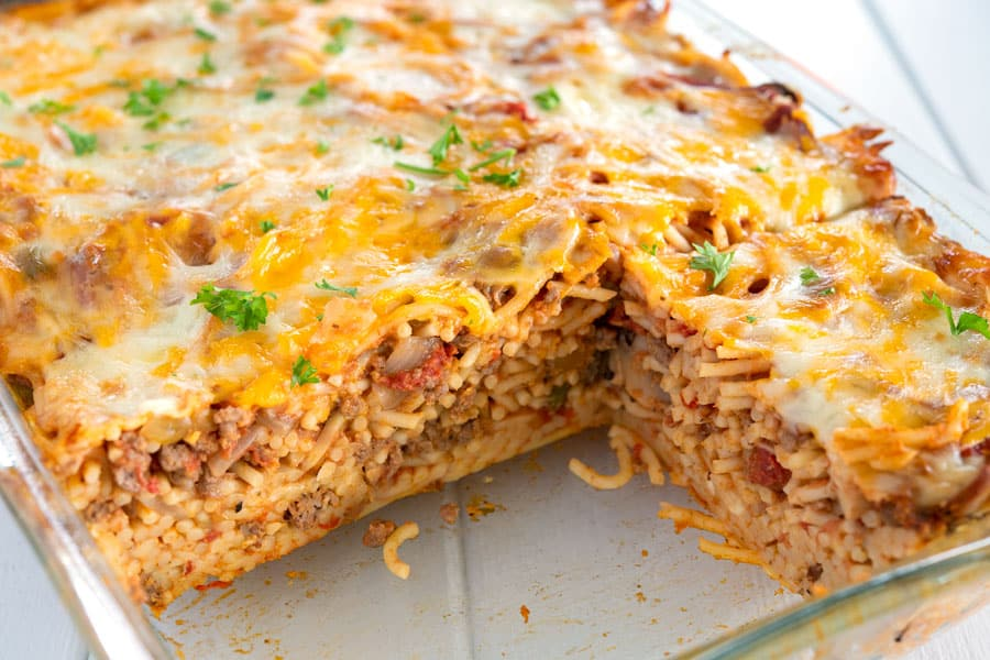 Easy baked spaghetti casserole topped with cheese