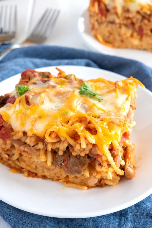 Slice of easy baked spaghetti on a white plate