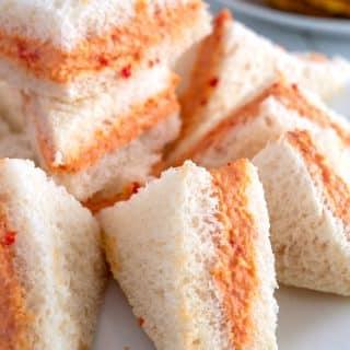 White plate piled with Puerto Rican sandwiches de mezcla