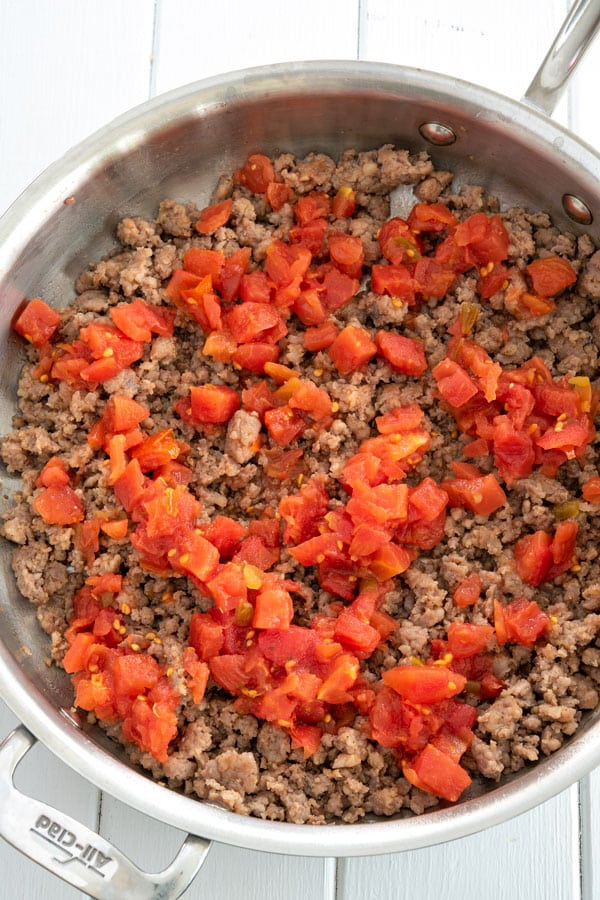 Sausage and Rotel cooking in skillet for sausage cream cheese dip