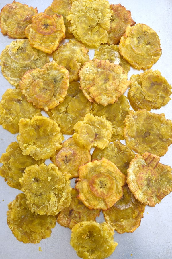 Layer of tostones on cookie sheet for tostone nachos