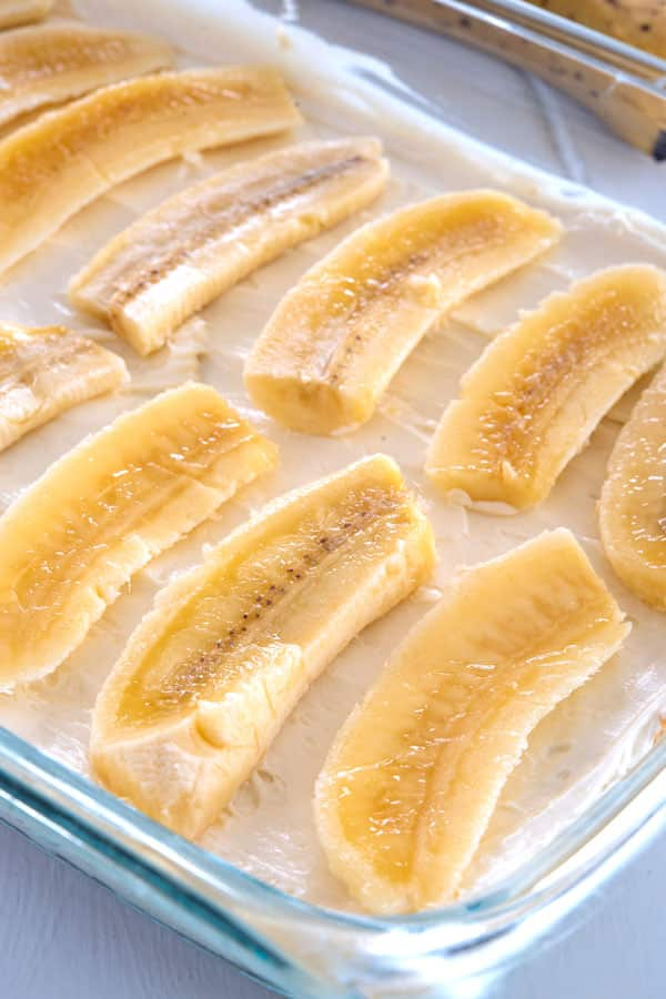 Slices of banana layered on no bake cream cheese pudding dessert