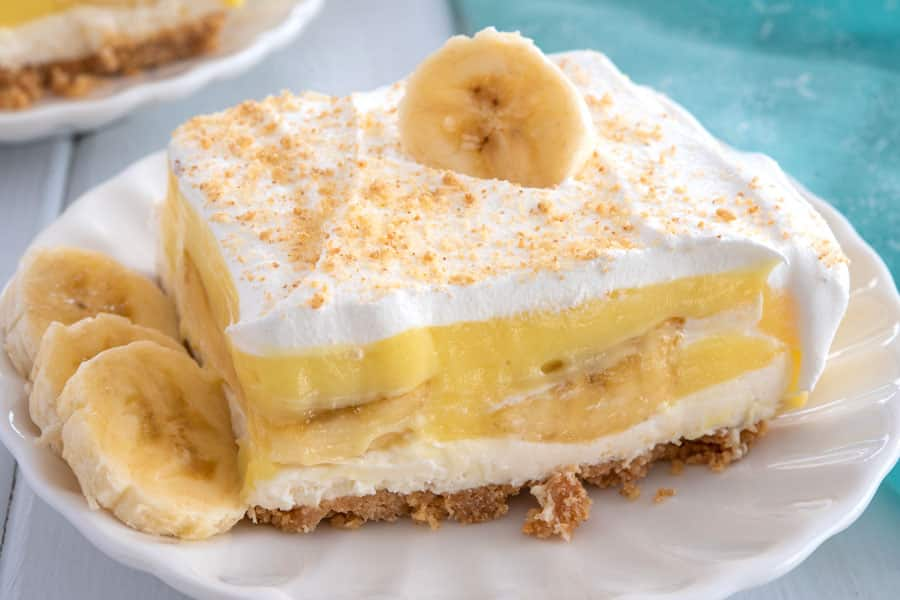 Slice of layered banana dessert on a small white plate